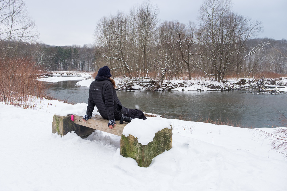 Stef gazes out over the snowy scene. The river used to be an important waterway for native American Indians.