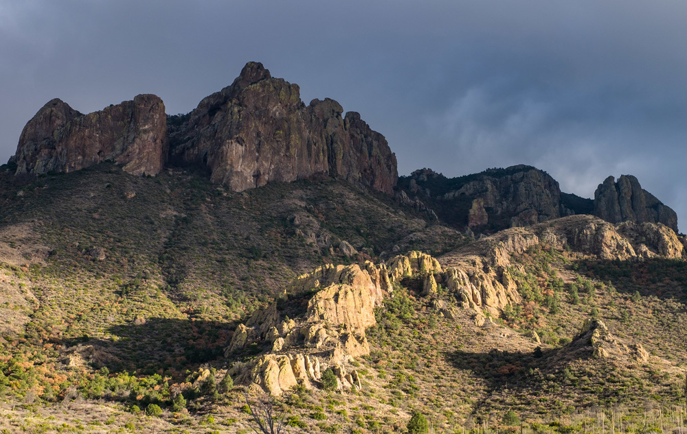 The sun sets on the Chisos Mountains that bisect the park.