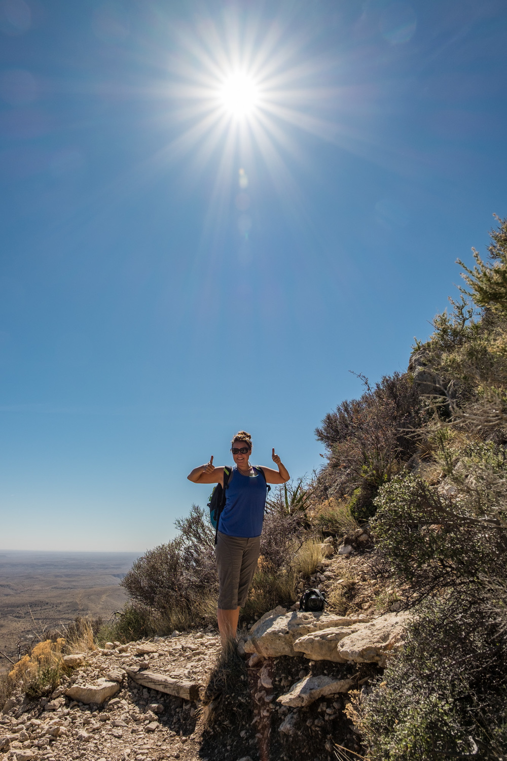 A sunburst over Stef on the Guadalupe Peak Trail.