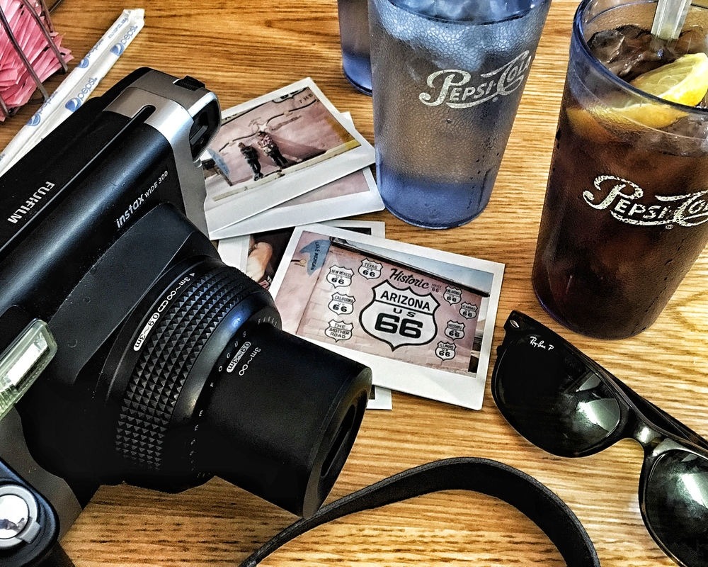 Amercana kitsch -- Fujifilm Instax, Pepsicola, and Ray Ban sunglasses at Joe & Aggies cafe in Holbrook, Arizona.