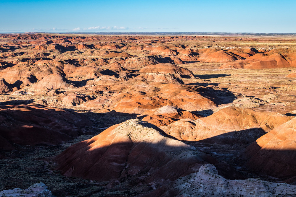 Shadows roll across the Painted Desert at sunset.