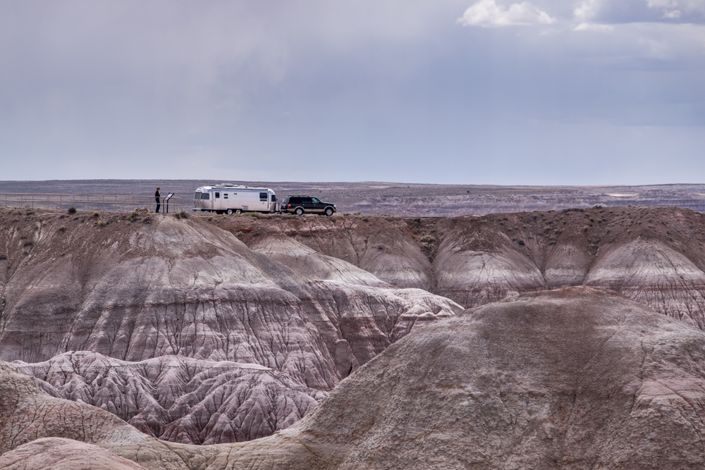 Wally the Airstream on the horizon at Blue Mesa in Petrified Forest National Park in Arizona.