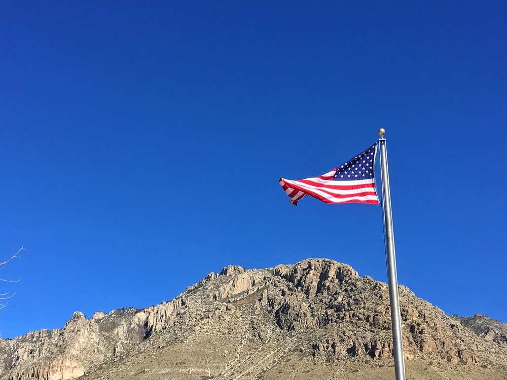A flag flies sky-high at Guadalupe Mountains National Park in Texas.