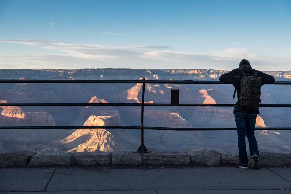 A traveler takes in the beauty of the South Rim.