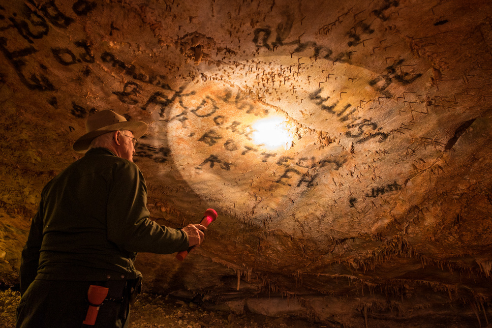 "Like many caves we've seen this year, early visitors felt the need to ""write"" their names in candle soot."