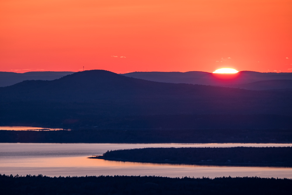 Sunset view from atop Cadillac Mountain. This is the location from where the United States is lit with its first rays of sunlight each day.