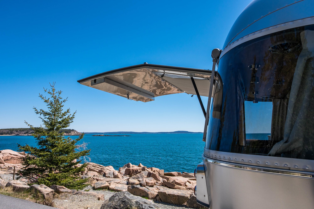 The back hatch that opens to the wilderness is our favorite feature in the National Parks Airstream Pendleton.