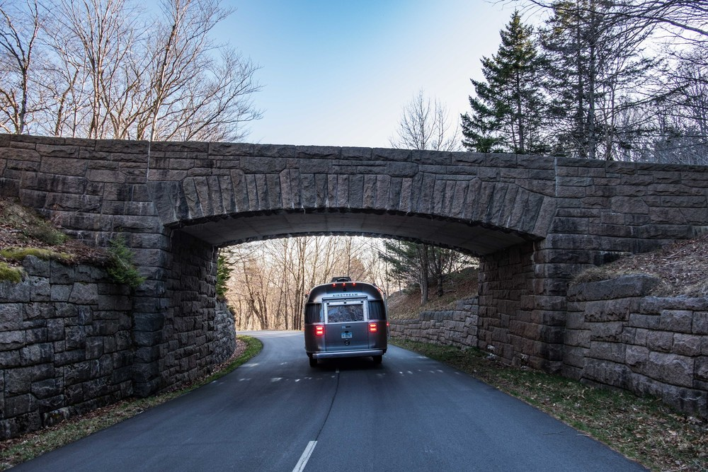 The Pendleton Limited Edition National Parks Airstream under a carraige road (a brainchild of John D. Rockefeller) in Acadia National Park in Maine.