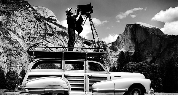A famous photo circa 1942 of Ansel Adams photographing Yosemite National Park with a full format camera. (Image courtesy of the Cedric Wright Family via The New York Times.)
