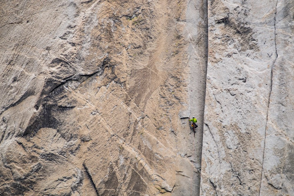 A climber makes his peace on the nose of El Cap.