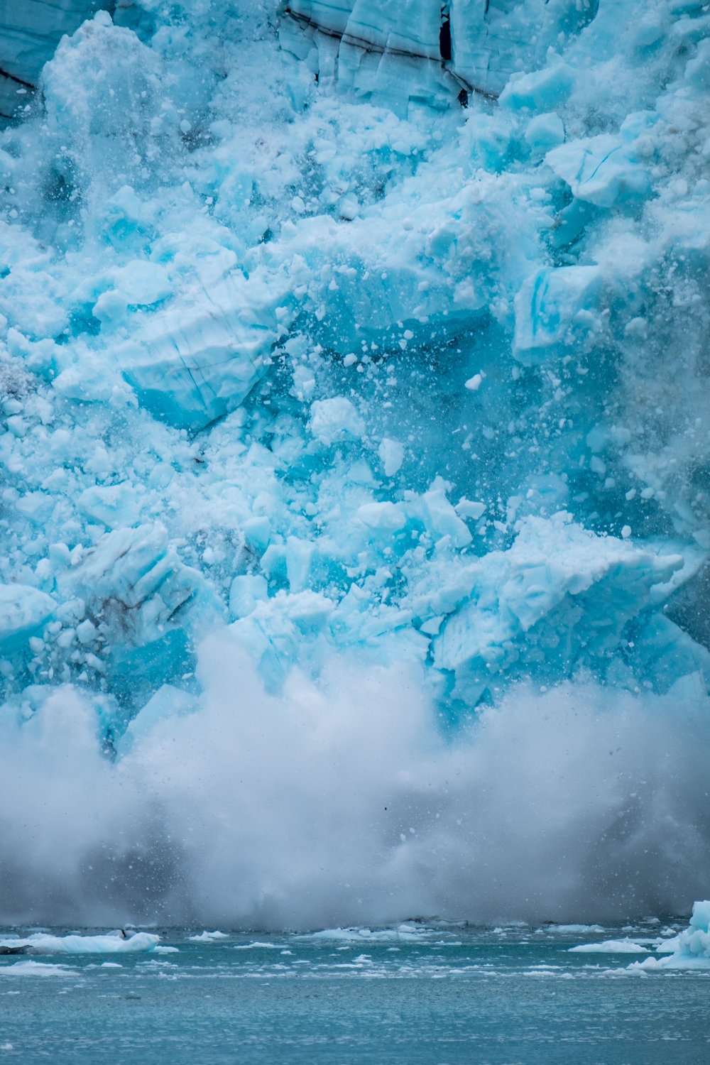 Glacial ice calving (breaking and falling) from Margerie Glacier.