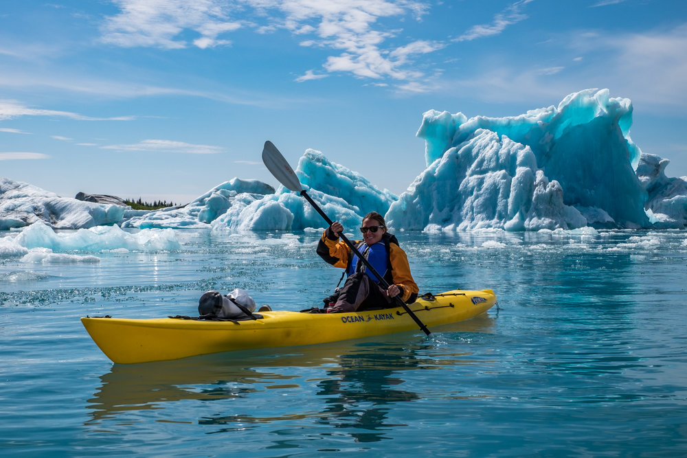 Stef paddles among icebergs in a protected lagoon off of Bear Glacier.