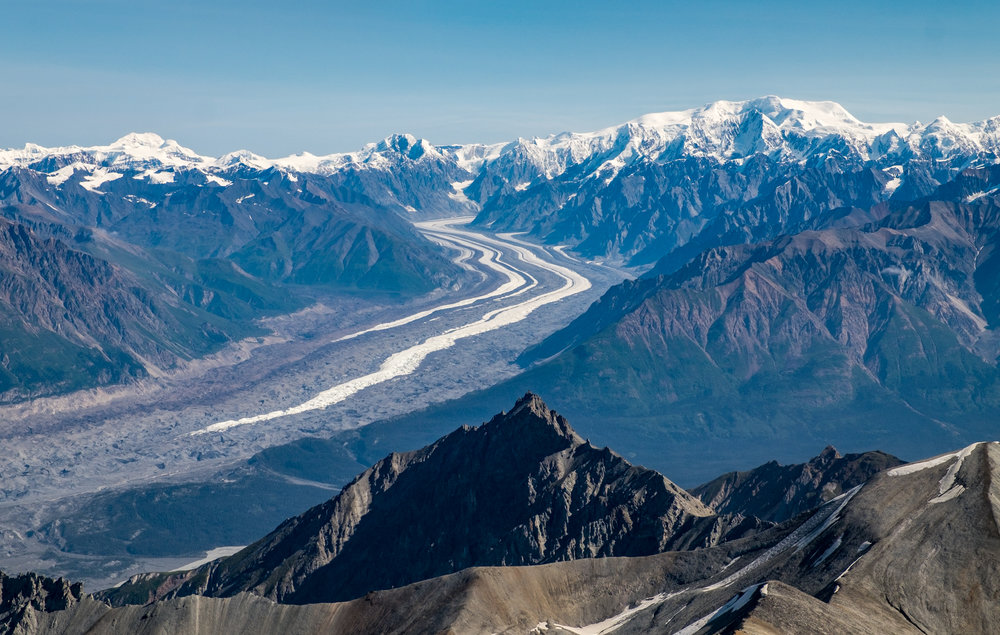 The St. Elias Mountain range gives way to glaciers and moraine. See that vertical spread of white and brown strips? We crossed all of that during our five day backpacking adventure. Awesome!!