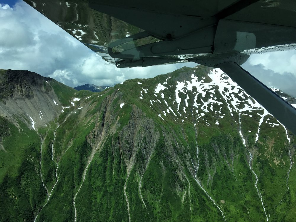 Flying through wild Alaska on one of 24 bush flights we took there this summer.... and the best part: *Airplane Mode* not required in bush planes!! Photo credit: Stefanie Payne