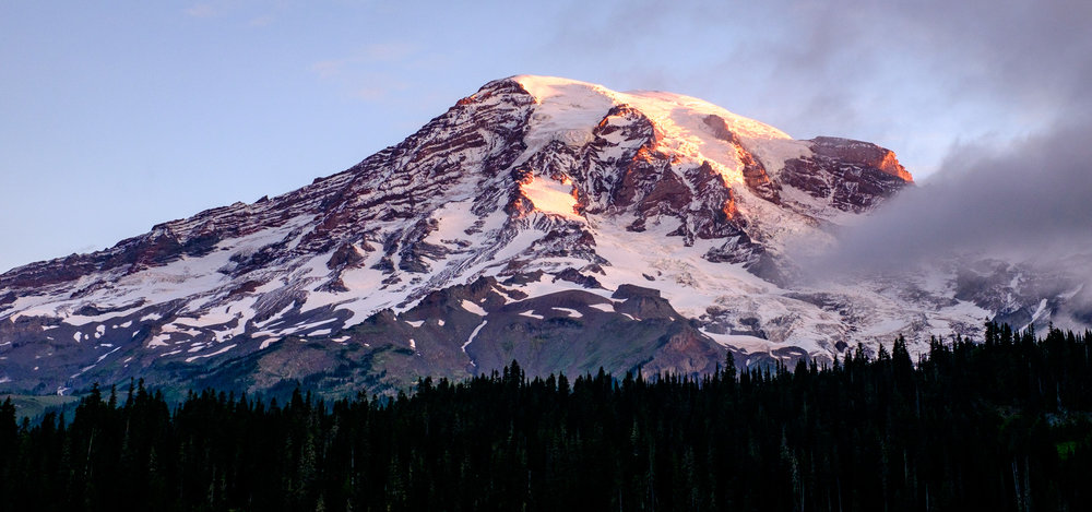 The iconic symbol of Washington State. Standing at 14,110 feet, Rainier creates its own weather systems.