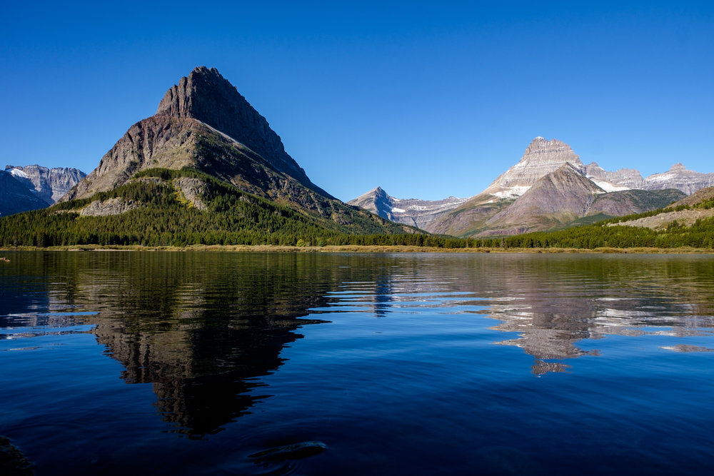 Amazing mountain views from the Many Glacier Lodge across Swiftcurrent Lake.