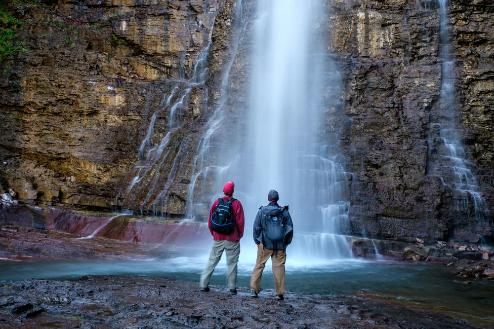 Our good pals Keith and Danny take in the skyward view at Virginia Falls.