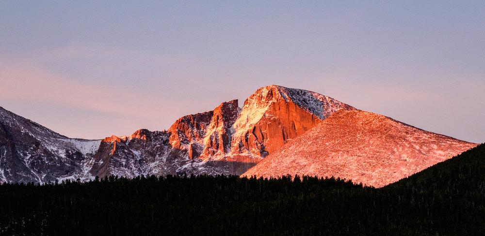 Longs Peak lit up at sunrise.
