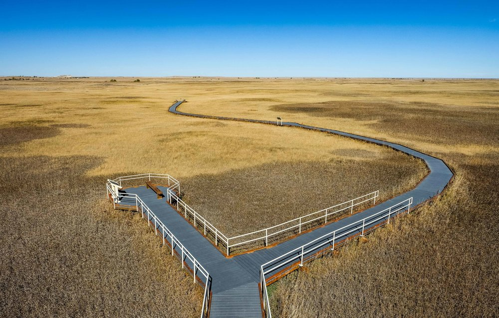 Sometimes to get a sense of a landscape, you must travel above it, as we did here with a mega-lift-tripod at the Prairie Wind Overlook. On this boardwalk you can stand among a vast expanse of prairie grasslands. At one time they covered 1-million miles of the North American landscape, equal to about 7 times the size of Minnesota; today they only make up 2% of the natural area.