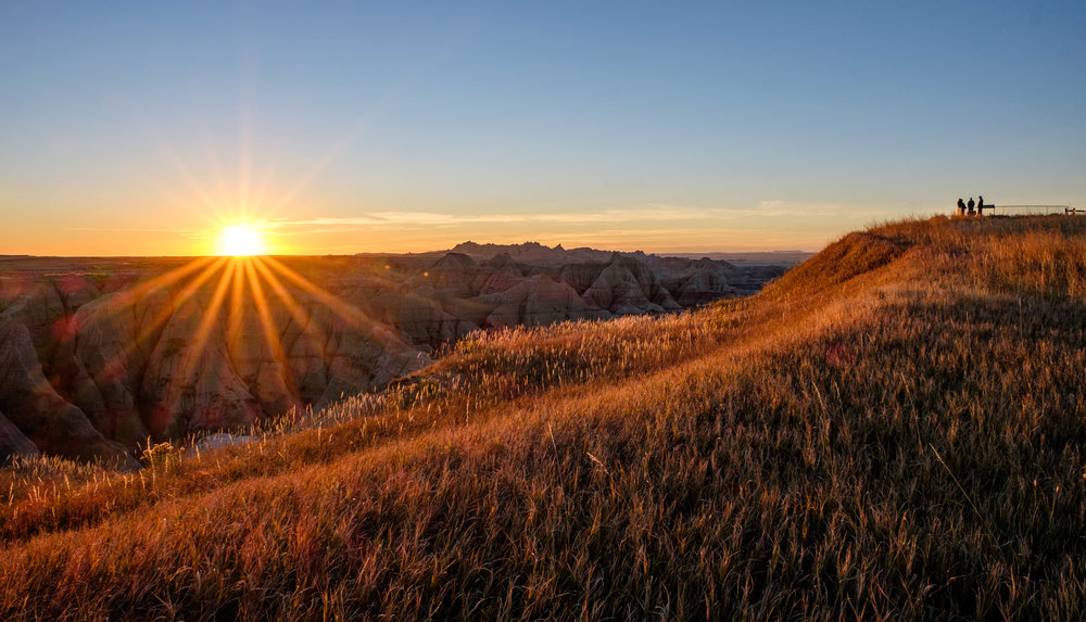 Prairie meets badlands at sunrise. Ah.