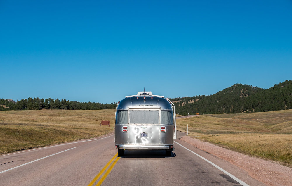 Wally the  Airstream  in his element driving through Wind Cave National Park in South Dakota!