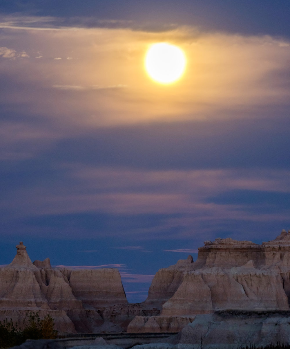 Supermoon rising in Badlands National Park in South Dakota.