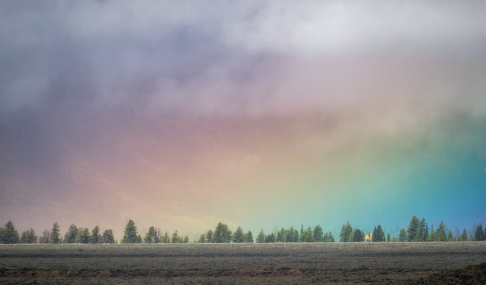 A beautiful prismatic sky in Grand Tetons National Park in Wyoming.