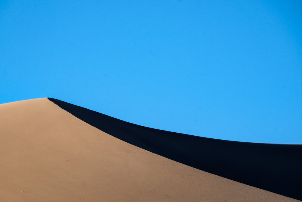 """Barchan dunes"" create what is considered a perfect half moon, and appear flattened on the surface."