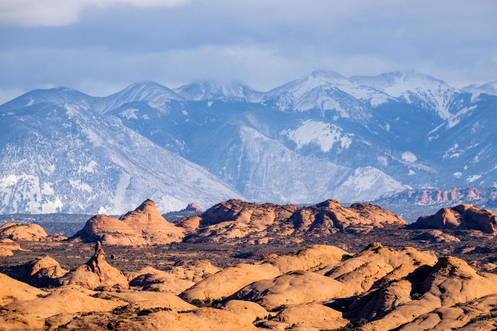 Petrified Dunes dot the landscape with the La Sal Mountains as a backdrop.