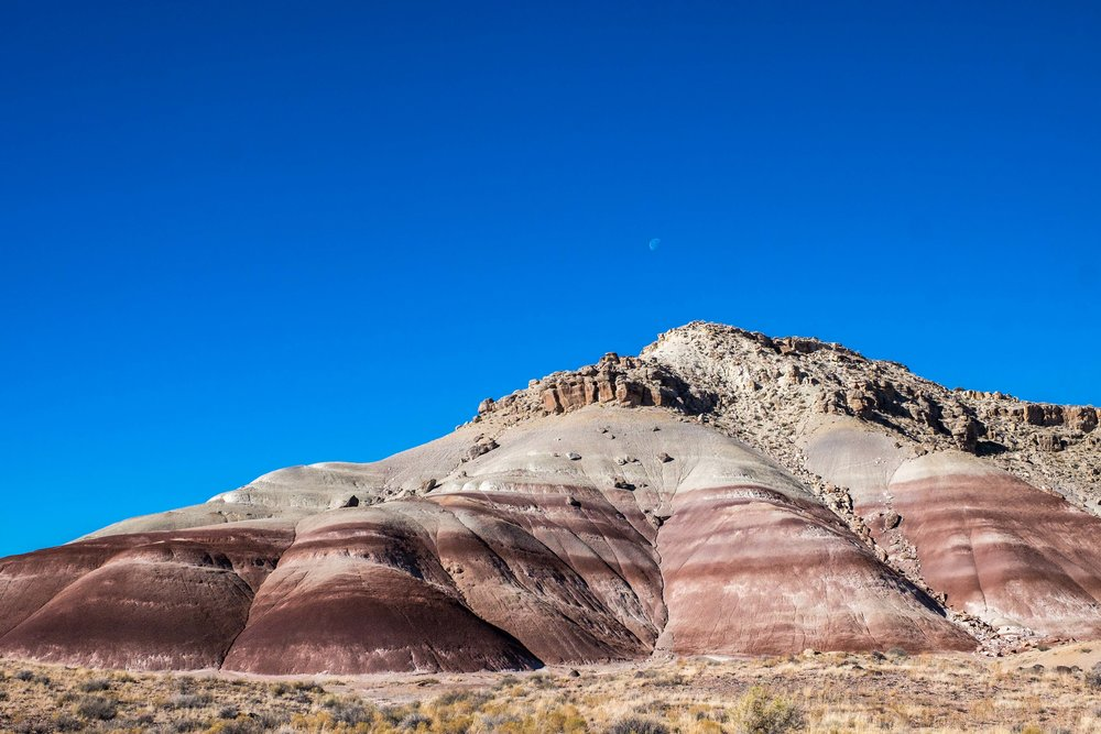 One of the first stops you come to on the road to Cathedral Valley is the Bentonite Hills.
