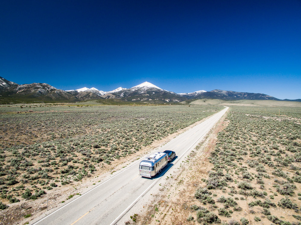 Wally the Airstream entering Great Basin National Park in Nevada. This drone shot was taken *outside* of the park boundaries and is perfectly legit. :)