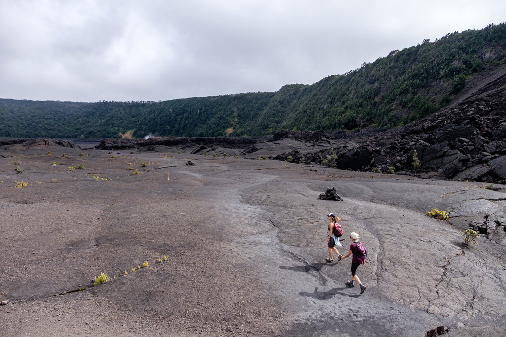 Hikers crossing the crater at Kīlauea Iki.