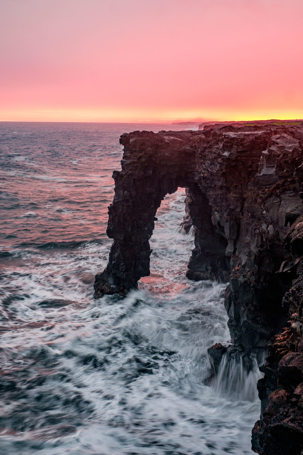 The Holei Sea Arch, photographed during an incredible pink sunset that turned the world an amazing shade of pink.