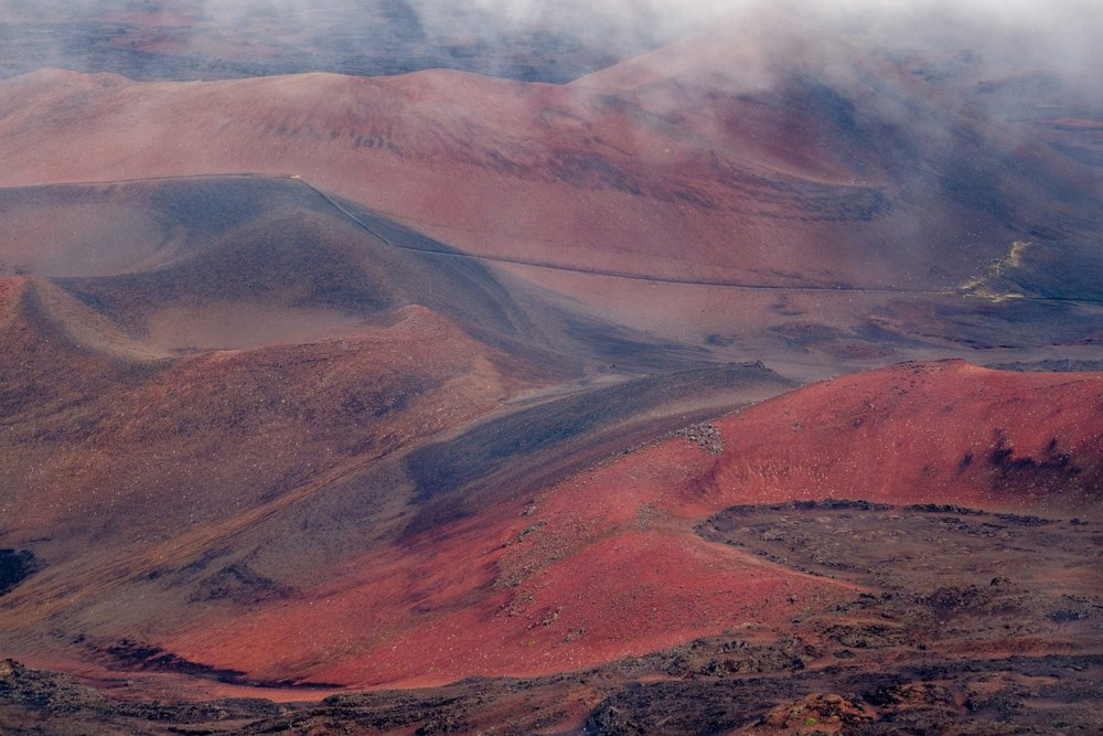 The red and brown sands deep inside the crater.