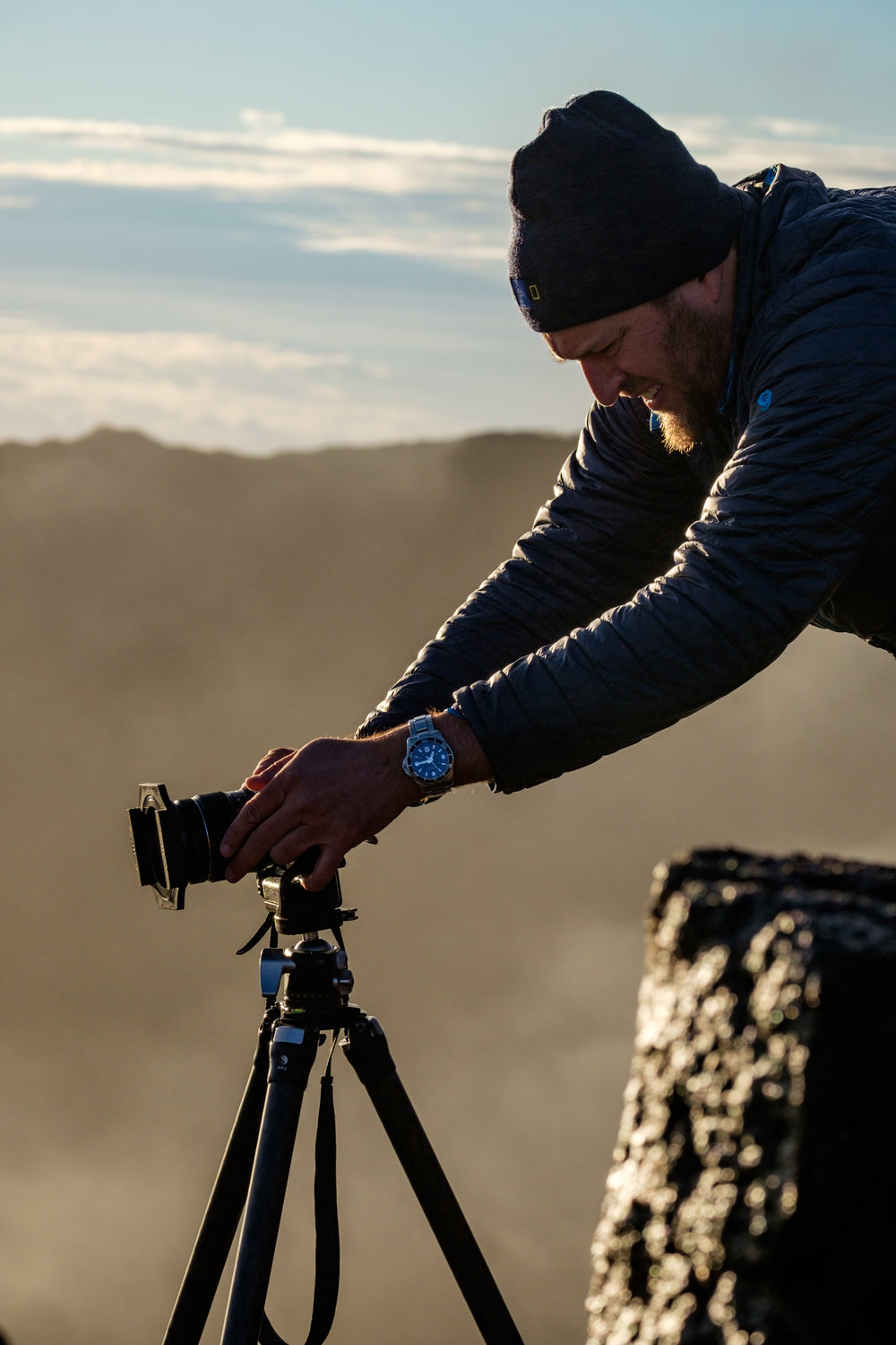 Jonathan futzing with his Fujifilm X-T1 during sunrise atop the crater.