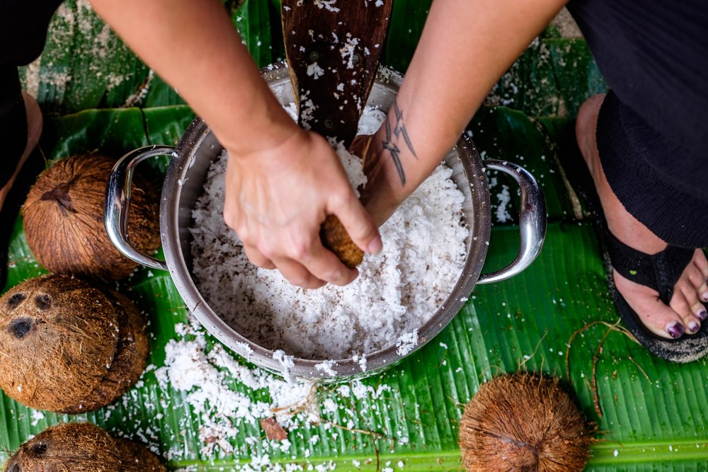 Stef participates too, here she is grinding the coconut.