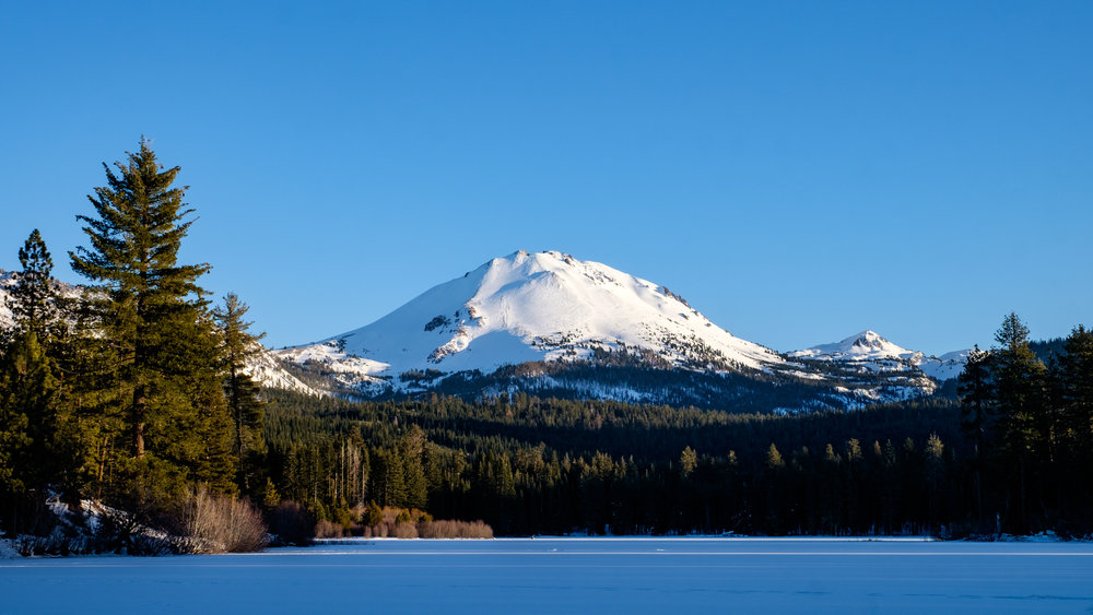 Lassen Peak from the north side of Manzanita Lake during the winter of the National Park Service centennial in 2016.