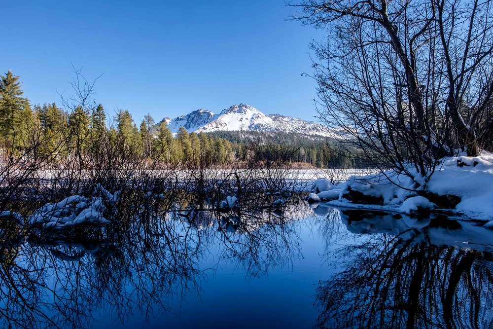 A serene setting at Manzanita Lake during the winter.
