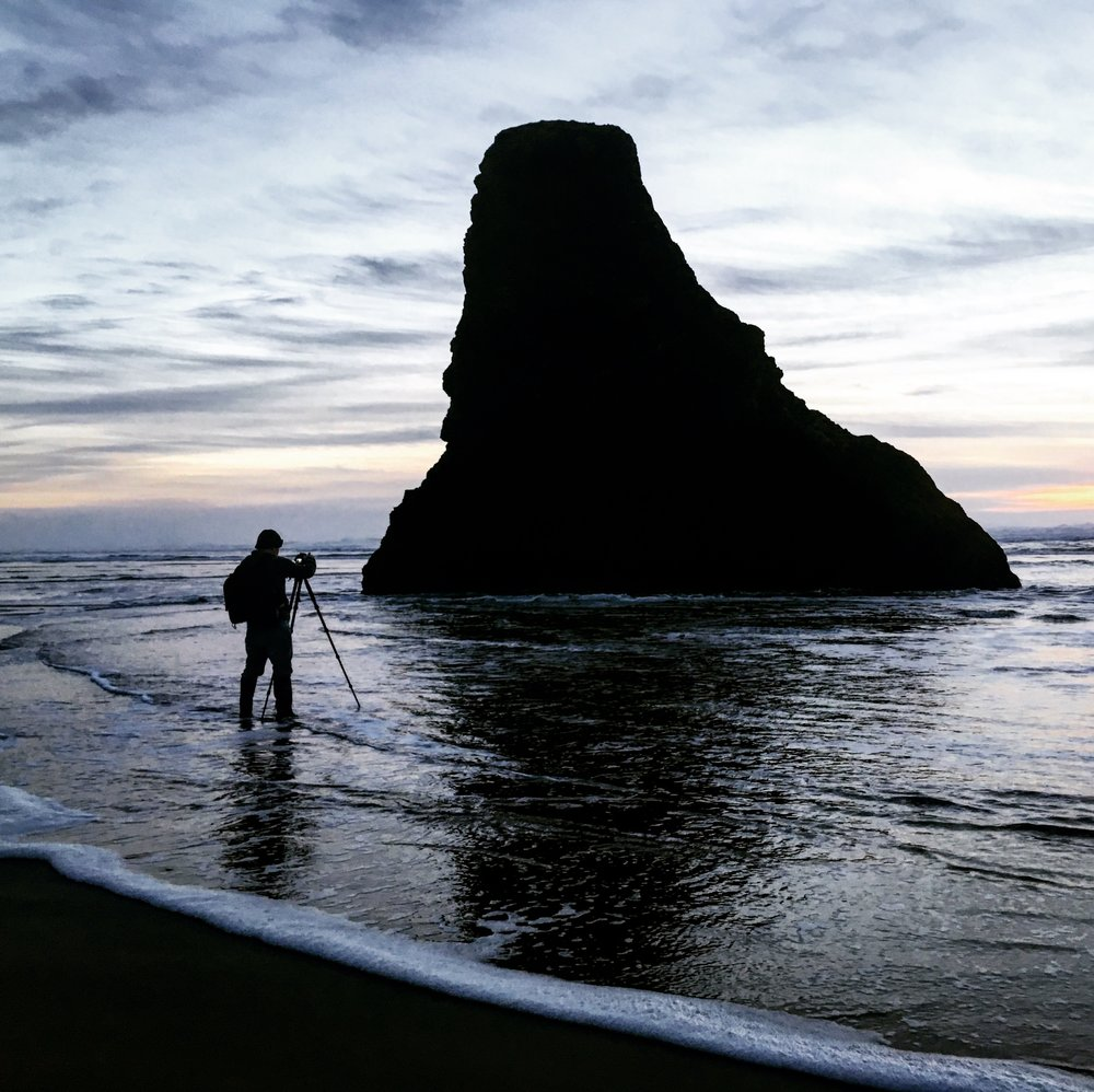 Jonathan Irish photographing the sea stacks on the Oregon coast | Photo by Stefanie Payne