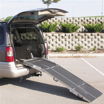 Attached spring assist van ramp