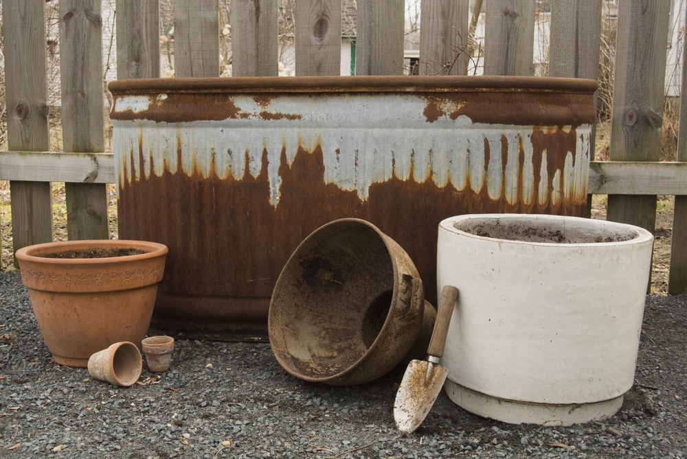 Terracotta pots, reclaimed pots including a stock tank, glazed pot