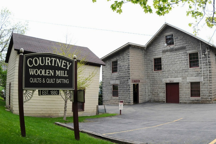 Courtney Woolen Mill - Appleton, Wisconsin - Specialty | Wool Mattress PadsTom has been such a great resource when it comes to processing our wool. His family has processed wool since 1880 and his passion and expertise in his craft shine through his work.