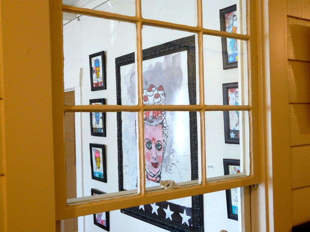 versus gallery interior through window art.jpg