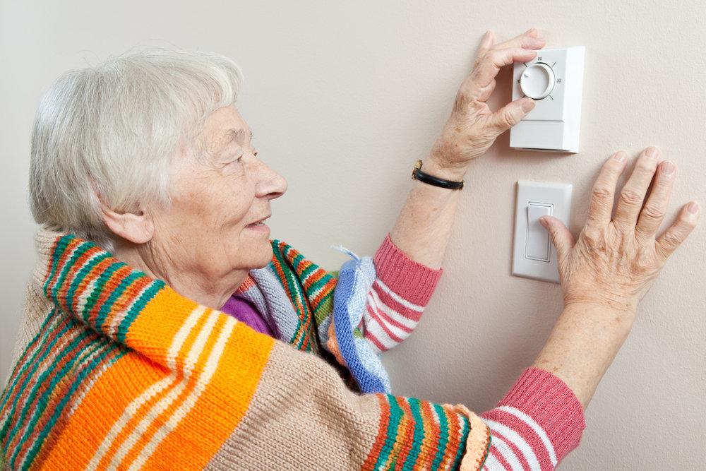 iStock-135849288_elderly-woman-adjusting-thermostat.jpg