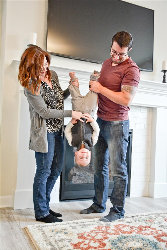 Chelsea, her husband Peter & son Kingston having some fun at their new house!
