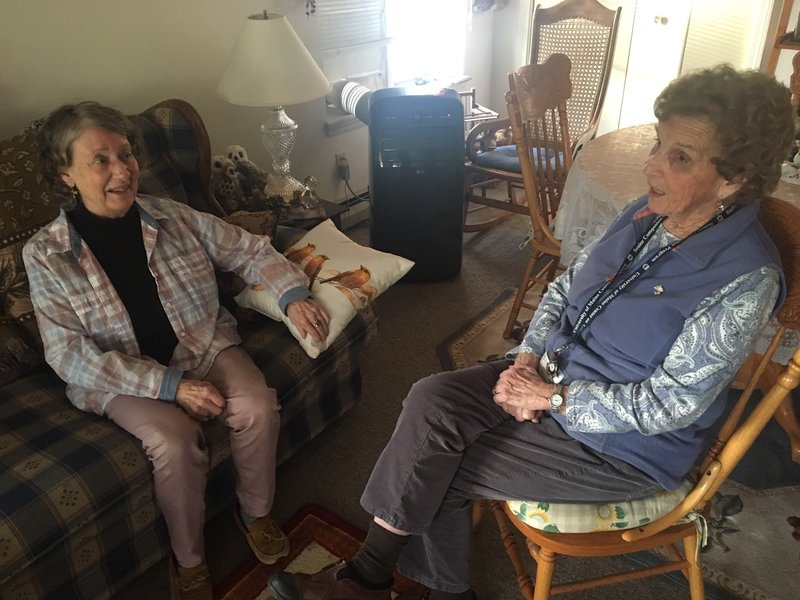 Client Wanetta Nurse (left) and senior companion Kitty Gee chat about topics like family, the good old days, and men.