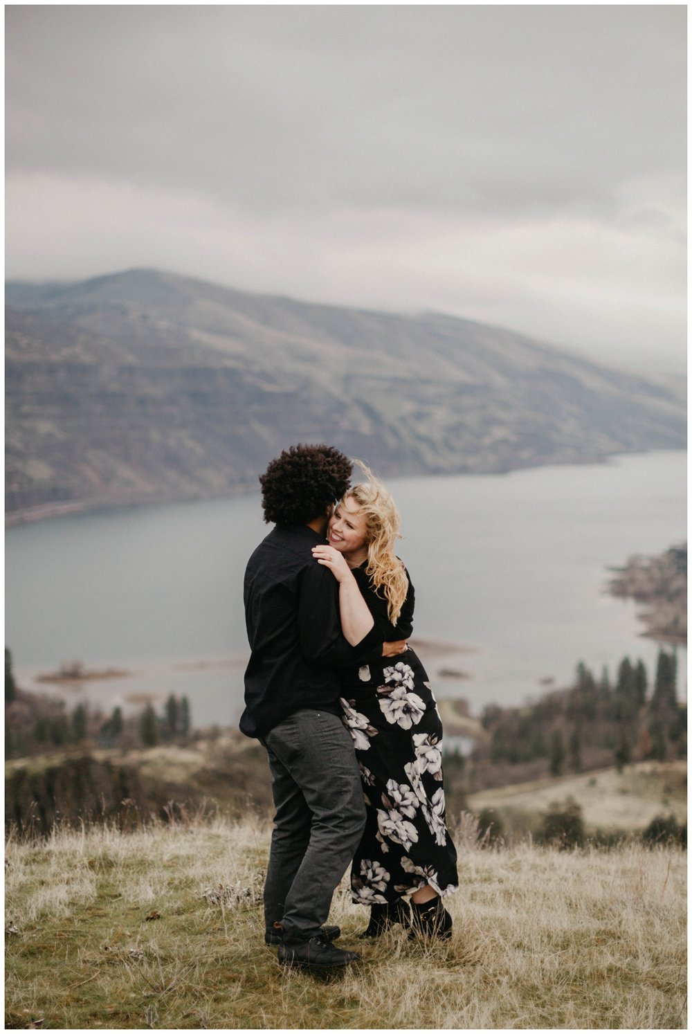 Couple hugging at the top of a hill near Rowena Crest.