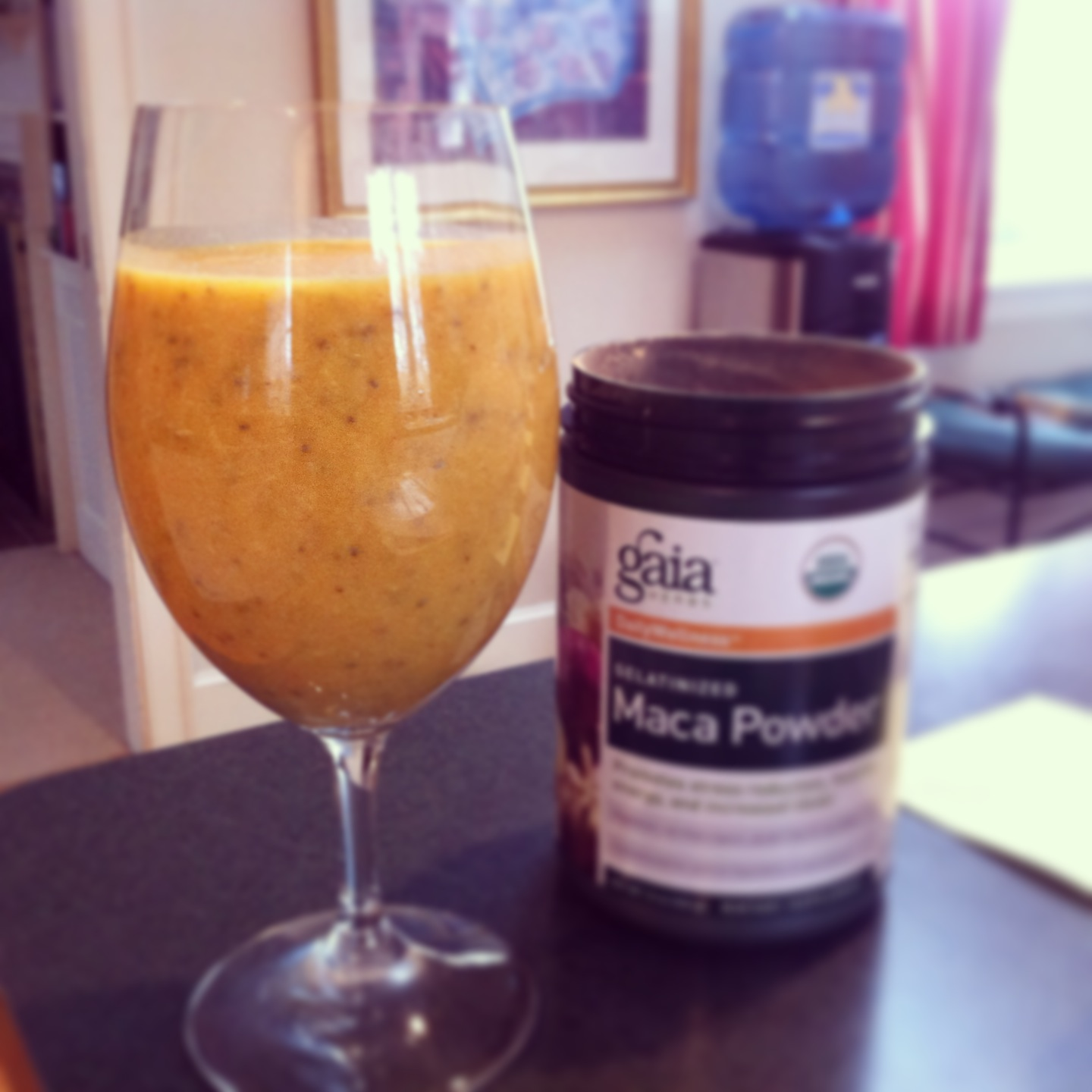 an ayurveda smoothie~pineapple and banana with turmeric, ginger, coconut oil , maca and almond milk
