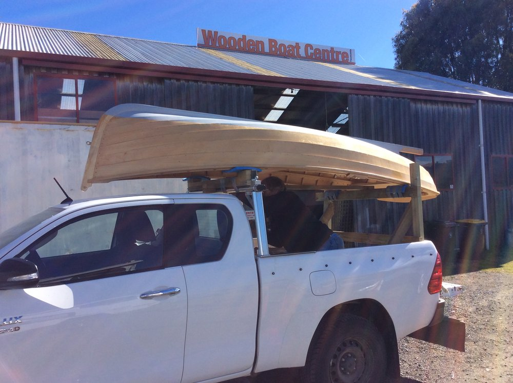 David loading and strapping his lovely Huon Pine Clinker dinghy for the journey back home to South Australia.  Happy Boating David and friends!