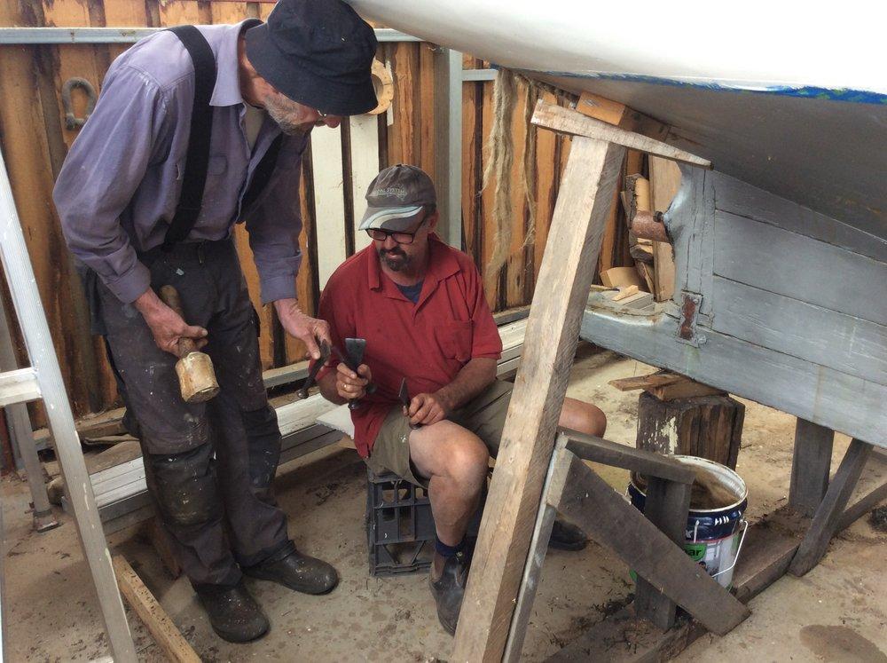 Discussing caulking tools.JPG